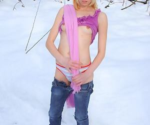 Sweet blonde teen Monica R strips to her socks and boots out in the snow