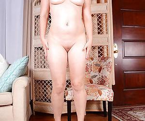 Older chubby brunette sliding underwear aside to reveal shaved vagina