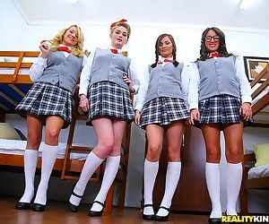 Naughty schoolgirls pull up plaid skirts and showing young twats