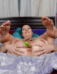 Mature fatty Kali Karinena plays with a weird dildo shoving it in a bald cunt
