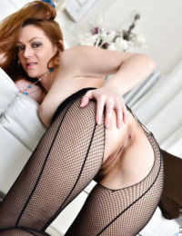 Pantyhose attired mature lady revealing hairy pussy for masturbation