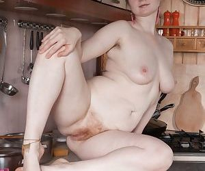 Thick solo model Bazhena undresses in her kitchen to show her beaver