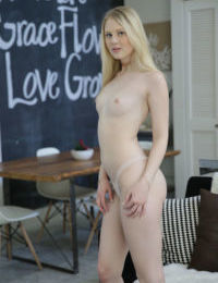 Blonde girl Lily Rader removes her dress and panties before toying her pussy