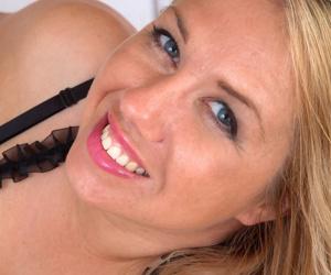 Mature blonde Elle Macqueen slips off satin panties to exhibit beaver