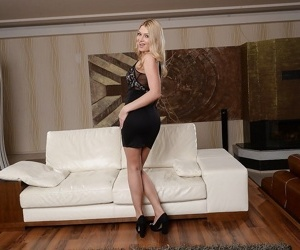 Euro blonde Lucy Heart modelling in high heels decides to get naked