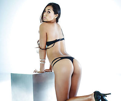 Bosomy babe Jeannie Santiago posing in lingerie and high-heeled shoes