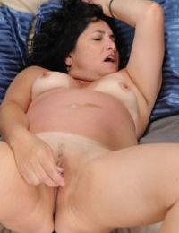Mature Latina Tess Romero uses a vibrator to please her clitoris