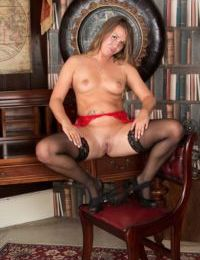 Mature lady Leo Star opens her pierced pussy in opulent surroundings