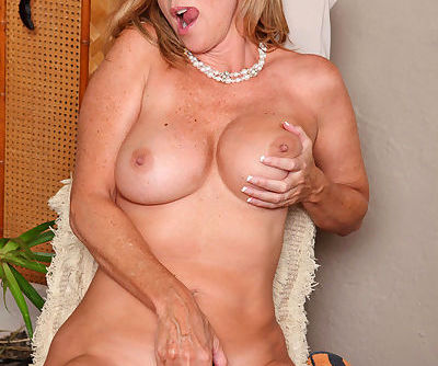 Classy older lady Jodi West strips and masturbates after a long day