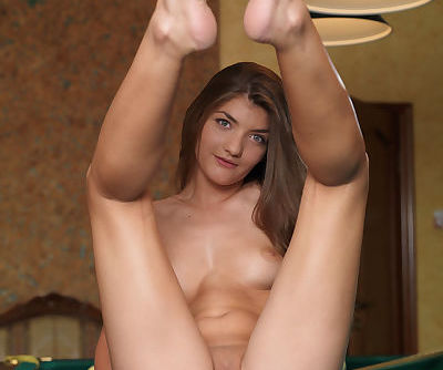 Sports girl Ryanel A displaying shaved snatch and tight ass on pool table