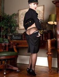 Older blonde stewardess Evey Crystal posing in stockings and high heels