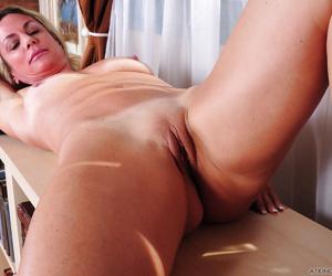 Blonde mom Sydney fondling boobs and spreading shaved MILF vagina