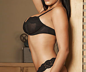 Curvaceous hottie Bunnie Brook taking off her lacy lingerie