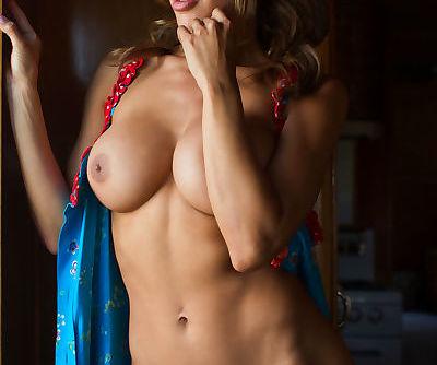 Leggy centerfold model Ana Cheri exposing big boobs for glamour shoot