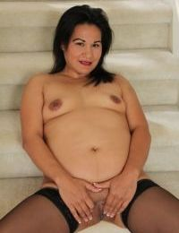 The spread shaved Asian pussy on mature babe Susie Jhonson looks tasty