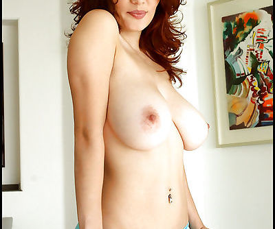 Busty babe in tight panties shows her beautiful body and big tits