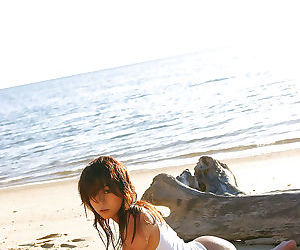 Loveable asian girl showcasing her seductive curves outdoor