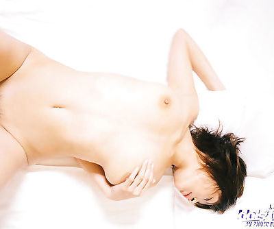 Naked asian lady Nana Natsume showcasing her tempting curves