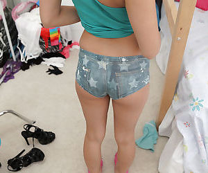 Hot coed Sara Luv shows off her tight teen buttocks in workout clothes