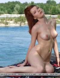 Gorgeous ginger slut Mia Sollis strips down completely at the beach