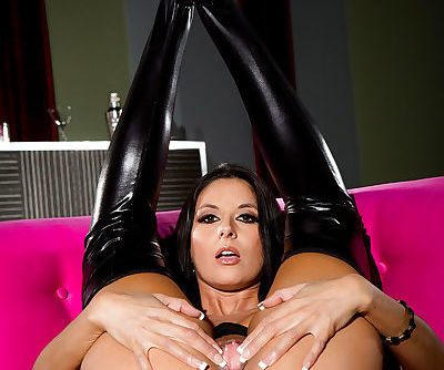 Brunette pornstar Nikki Daniels spreading pink pussy in long latex boots