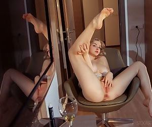 Hot slut Daniel Sea in bare feet undressing to finger her wet shaved pussy