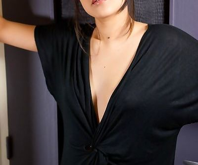 Asian solo model takes off her shades and then her little black dress