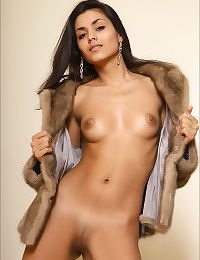 Very gorgeous girl naked under her fur coat spreading her long legs wide open
