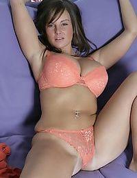 Top-heavy brunette amateur undressing and fingering her gash