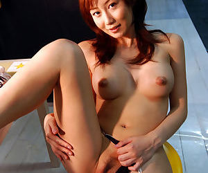 Sweet asian coddle Yuri Seto detection her full of life bosom added to whiskered cunt