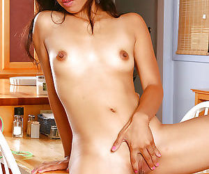 Amateur Asian lady Talia letting her tiny breasts loose from blouse