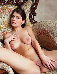 Long legged erotic model Marga A undressing to spread pussy lips