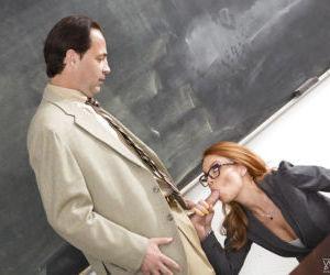 Nerdy redhead teacher Britney Amber sucking cock and balls in classroom