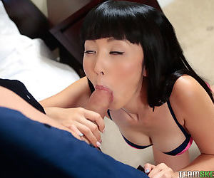 Glamour Asian brunette Marica Hase unbuttons her guys jeans and engulfs cock