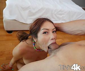 Playful Asian bimbo Samantha Parker gives a mouth job and sucks balls