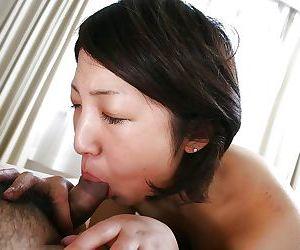 Emi Ishibashi gives a blowjob and gets her hairy pussy shagged hardcore