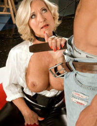Mature blonde photographer seduces her male subject in leather pants