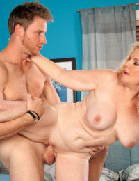 Older lady Charlie seduces a younger man wearing a satin bra
