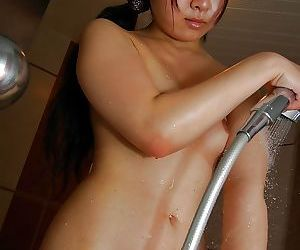 Asian babe taking shower and rubbing her shaggy slit in close up