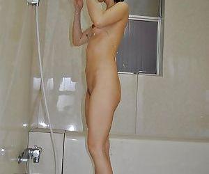 Asian MILF Mayumi Iihara taking shower and teasing her gash with water jets