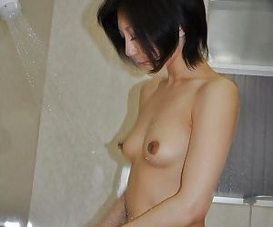 Asian MILF Mayumi Iihara taking shower and teasing her gash with water jets