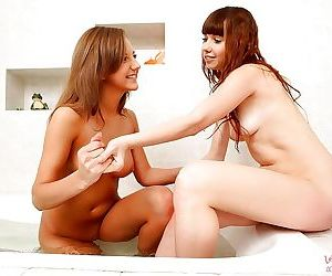 Young sexy lesbians Inna & Zhenia having nasty fun in the bathroom