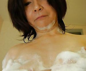 Sassy asian mature young gentleman apropos unshaven pussy added to with an eye to bowels taking shower