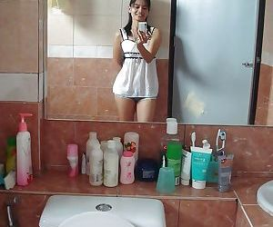 Petite Thai girl tales self shots before stripping naked in bathroom