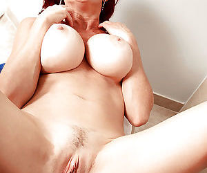 Aged redhead Karen Kougar undressed for sex in bathtub by younger man