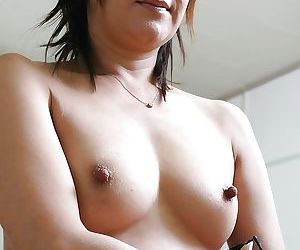 Keiko Ayata taking a hot bath and showing her forms on camera