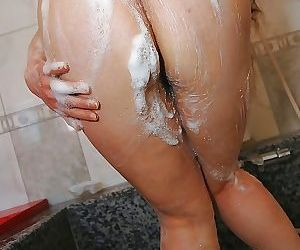 Naughty asian MILF with ample ass Ayako Sakuma taking shower and bath