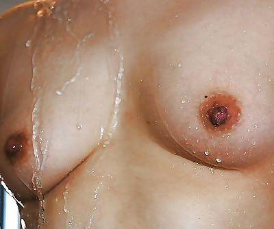 Naughty asian MILF with ample ass Ayako Sakuma taking shower and bath