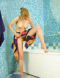 Stellar babe Luba taking a bath and showing that cute hairy pussy