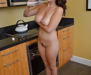 Sexy Asian Mai Ly strips naked in the kitchen to wet her big tits for fondling